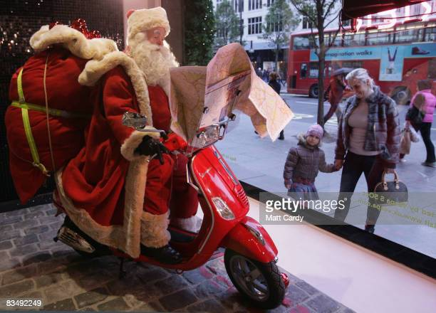 People look into the window of Selfridges as the store unveils its new Christmas display on October 30, 2008 in London, England. Featuring Santa...