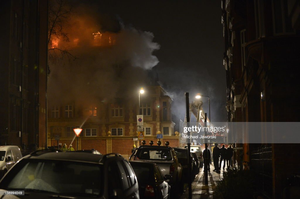 People look on as firefighters try to extinguish a fire which has been ablaze since around midnight from a building under renovation in Moscow Road, Notting Hill on January 5, 2013 in London, England. It is thought that nobody was inside the building.