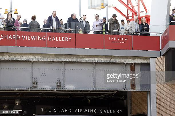 People look on as firemen work in the area as people evacuate The Shard on June 5 2014 in London England The Shard London's tallest building standing...