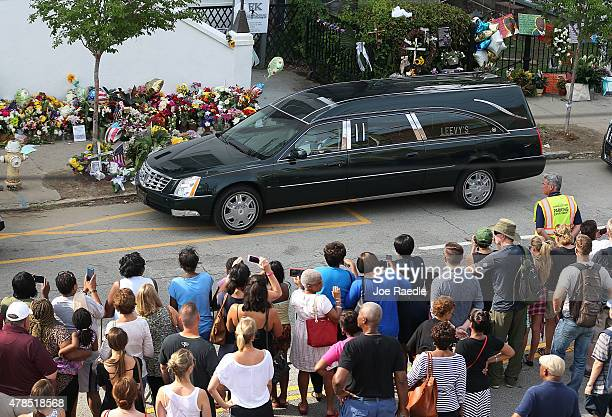 People look on as the hearse carrying the casket of church pastor and South Carolina State Sen Clementa Pinckney passes by in front of the Emanuel...