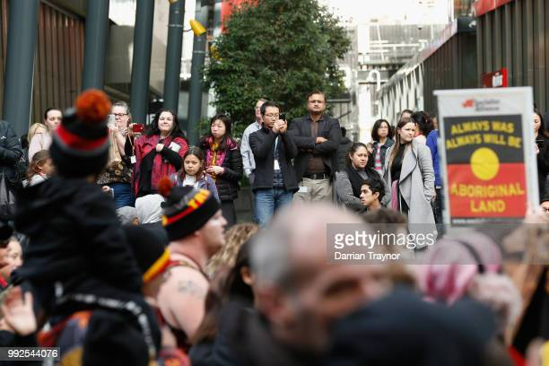 People look on as thousands of people take part in the NAIDOC march on July 6 2018 in Melbourne Australia The march marks the start of NAIDOC Week...