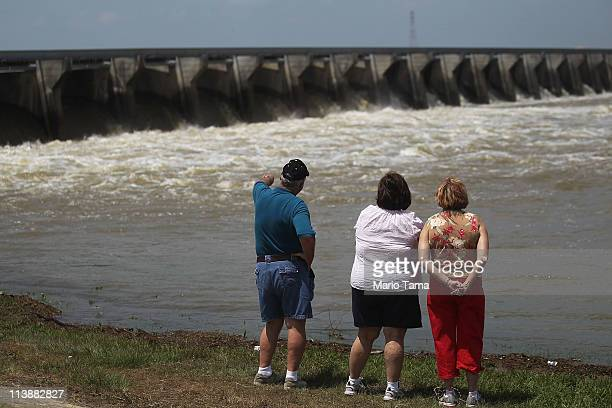 People look on as water from the rising Mississippi River is released through the Bonnet Carre Spillway May 9 2011 in Norco Louisiana The Army Corps...