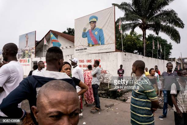 People look on during a demonstration calling for the President of the Democratic Republic of the Congo to step down on January 21 2018 in Kinshasa...