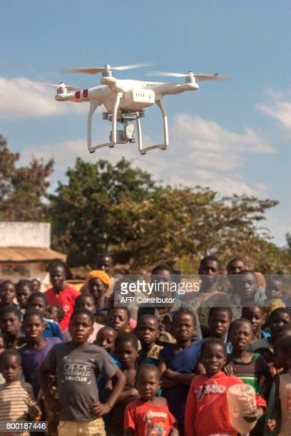 People look on during a drone awareness and safety demonstration on June 22 in regards to humanitarian drone corridor testing under the UNICEFfunded...