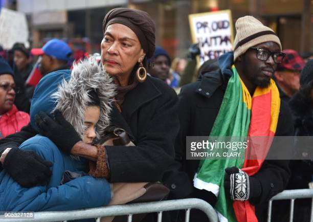 People look on during a march on Martin Luther King Jr Day in Times Square called Rally Against Racism Stand Up for Haiti and Africa in New York...