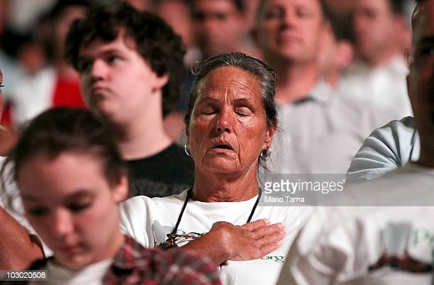 People look on during a moment of silence for the eleven Deepwater Horizon oil rig workers killed during the Rally for Economic Survival at the...