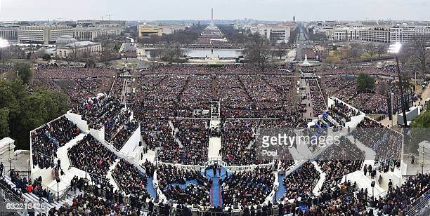 People look on during the Inauguration of President Donald Trump on January 20 2017 at the US Capitol in Washington DC In today's inauguration...