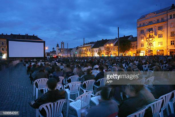 People look on during the public screening of the Romanian movie 'When I want to whistle I whistle' of Florin Serban at the Transylvania...