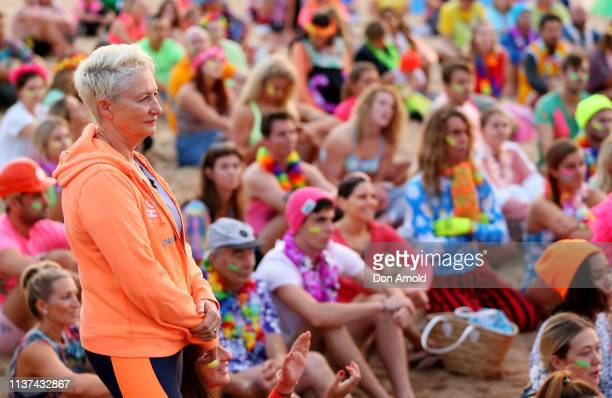 People look on solemnly as One Wave founder Grant Treblico addresses the crowd on March 22 2019 in Sydney Australia Surfers gather to celebrate five...
