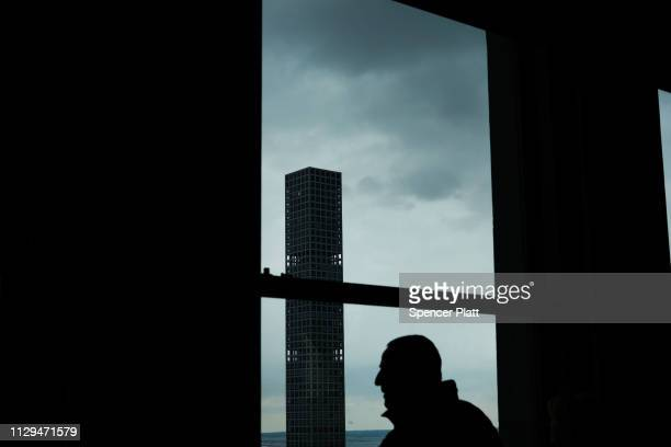 People look out at 432 Park Avenue the tallest residential building in the world on February 13 2019 in New York City Newly built and ultra slim...