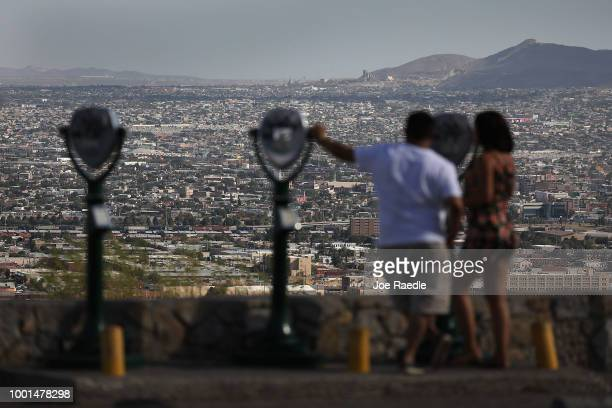 People look out at the skyline of El Paso and Ciudad Juarez Mexico on July 18 2018 in El Paso Texas A courtordered July 26th deadline is approaching...