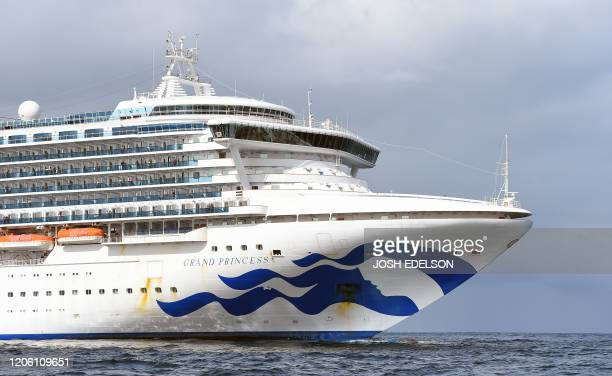 People look out from aboard the Grand Princess cruise ship operated by Princess Cruises as it maintains a holding pattern about 25 miles off the...