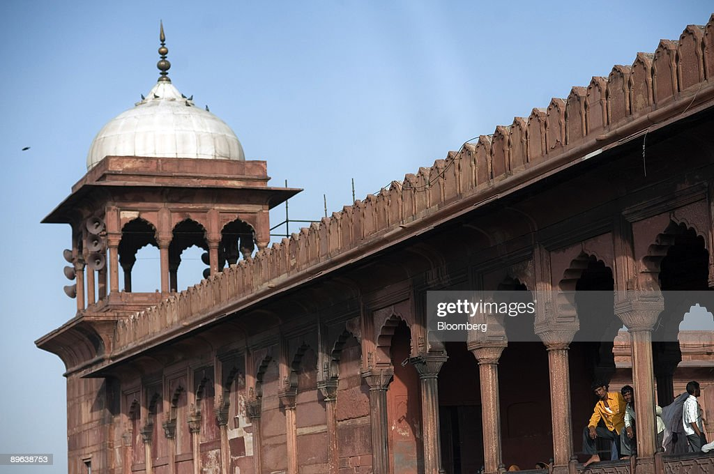 People look out from the Jama Masjid mosque in New Delhi, In : News Photo