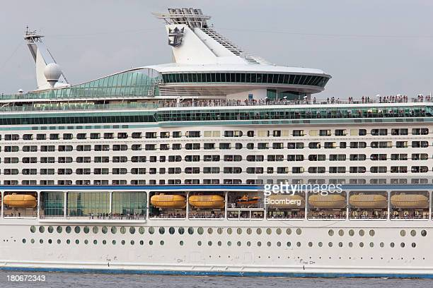 People look out from the Royal Caribbean Cruises Ltd's Voyager of the Seas as it departs the Ohi wharf in Tokyo Japan on Saturday Sept 14 2013 Royal...