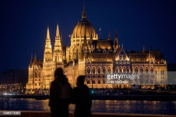 People look out over The Hungarian Parliament Building on January 19 2019 in Budapest Hungary The Parliament building has become a site of growing...