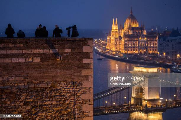 People look out over The Hungarian Parliament Building on January 20 2019 in Budapest Hungary The Parliament building has become a site of growing...