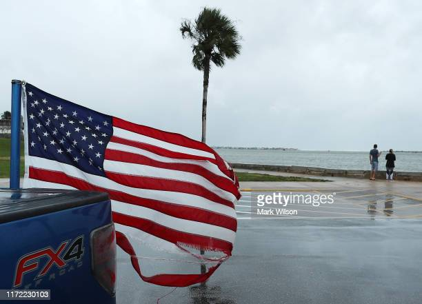 People look out over the water after Hurricane Dorian passed through the area on September 4 2019 in St Augustine Florida The slowmoving Dorian which...