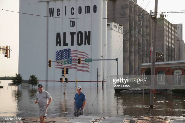 People look over an area flooded by the Mississippi River near Ardent Mills and the historic downtown on May 31 2019 in Alton Illinois The...