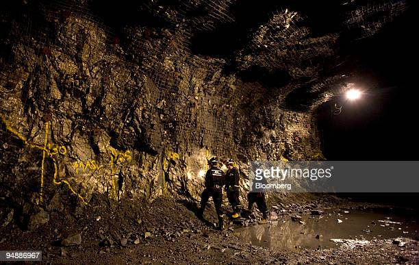 People look over an outcropping of a copper and nickel deposits 2750 feet below the surface at the Podolsky Mine owned by the FNX Mining Company Inc...