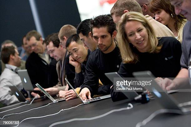 People look over the new Mac Book Air at the 2008 Macworld at the Moscone Center January 15 2008 in San Francisco California The new ultra thin...