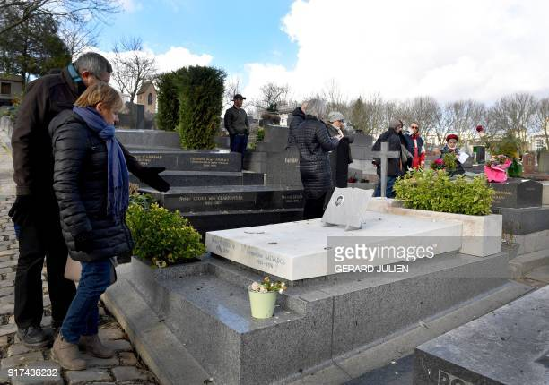 People look the gravestone of French singer Henri Salvador at the Pere Lachaise cemetery in Paris on February 12 on the eve of the tenth anniversary...