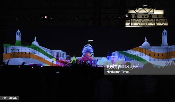 People look the Multimedia show to mark the 70th year of Independence at India Gate Lawns on August 11 2017 in New Delhi India