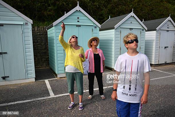 People look to the sky during the Bournemouth Air Festival on August 18 2016 in Bournemouth England The air show runs from the 18th to 21st August...