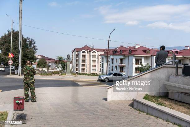 People look to the west, in the direction of the front line, as an air raid siren sounds on September 29, 2020 in Stepanakert, Nagorno-Karabakh. A...