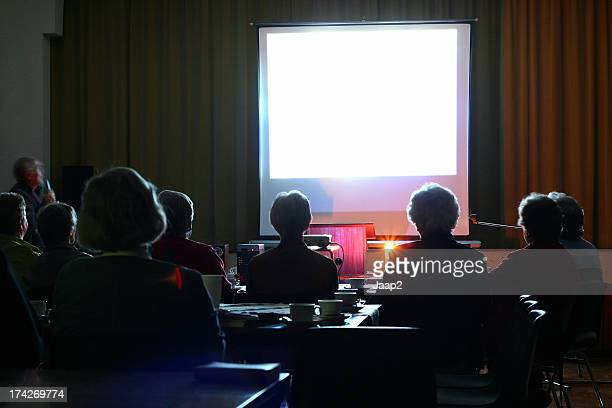 People looking at an evening presentation