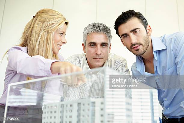 3 people looking at architectural model - 建築模型 ストックフォトと画像