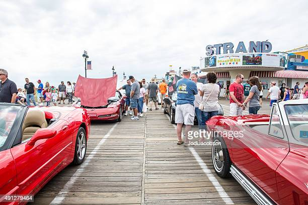 people looking at corvettes during car show in ocean city - cape may stock pictures, royalty-free photos & images