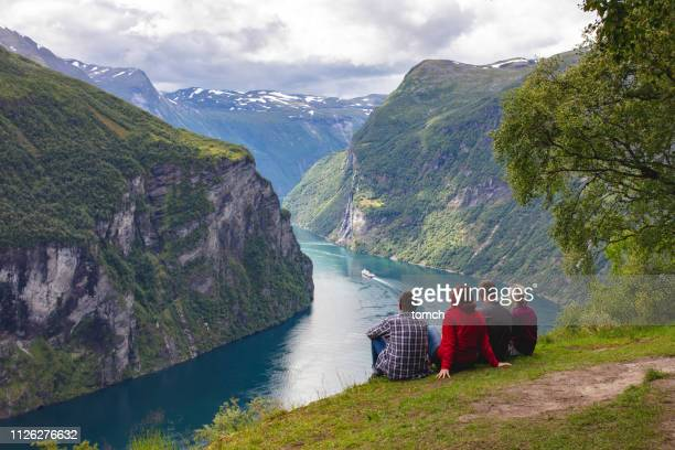 people looking at the geirangerfjord, norway - norway stock pictures, royalty-free photos & images