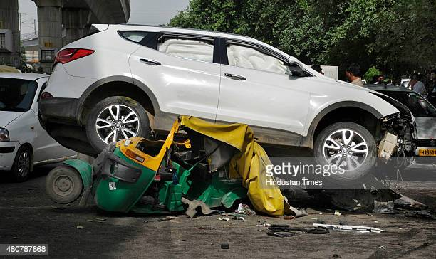 People looking at the Hyundai SUV car which crashed into an autorickshaw after it was shot at by unidentified persons at MG Road on July 15 2015 in...