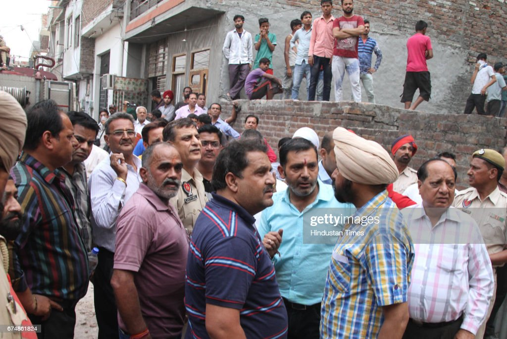 People looking at the massive fire at RNG Textiles near Basti Jodhewal Chowk on April 29 2017 in Ludhiana India Nobody is injured in the incident...