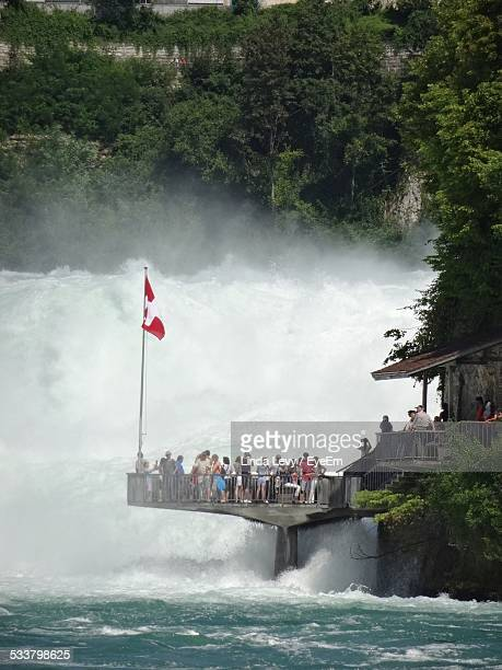 People Looking At View Of Rhine Falls From Observation Point