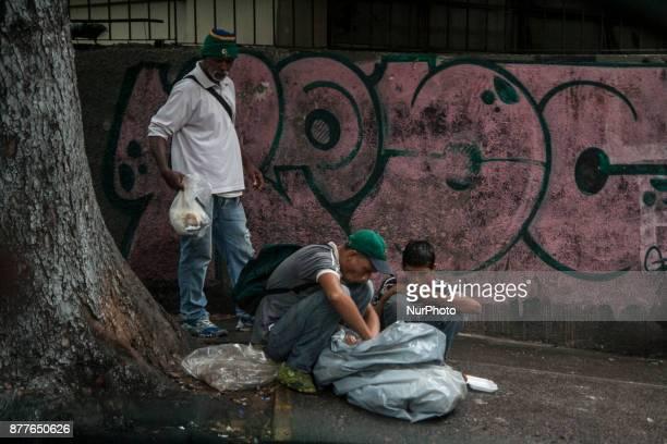 People looking for food residues in the garbage in Caracas Venezula on 23 November 2017 Venezuel people lives between the alert crisis and...