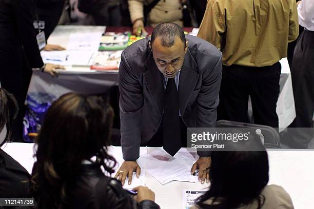 People looking for jobs speak with potential employers at the Brooklyn Job Fair on April 13 2011 in the Brooklyn borough of New York City Thousands...