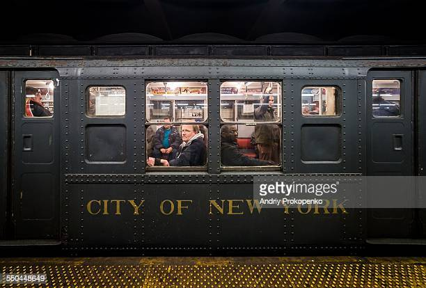 People looking out of the window on the NYC 'Nostalgia' vintage subway train New York City USA