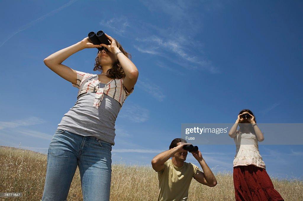 People Looking Through Binoculars Stock Photo