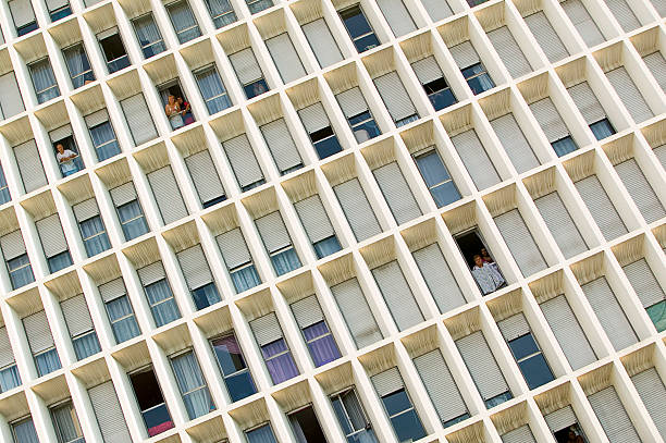 People looking through windows in buildings with abstract...