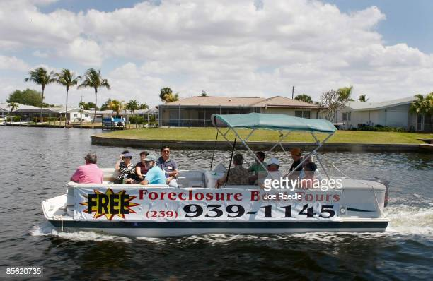 People looking to buy a home at a good price ride in a boat as Foreclosures 'R Us realty company takes them on a foreclosure boat tour on March 26...