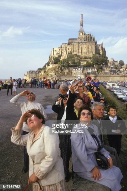 People looking up to archangel Saint Michel statue back at the top of abbey by helicopter after restoration on October 4 1987 in Le Mont Saint Michel...