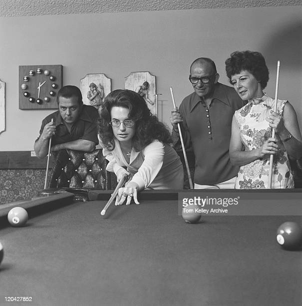 people looking while woman playing pool - old men playing pool stock pictures, royalty-free photos & images
