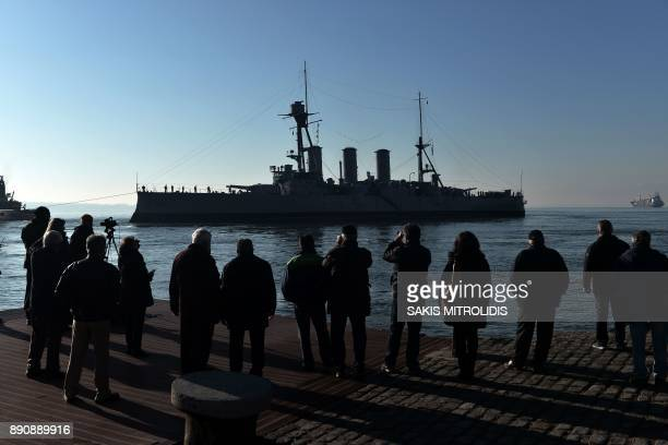 People looks at the historic Greek warship Averoff a floating museum who leaves the port of Thessaloniki on December 12 2017 The historysteeped...