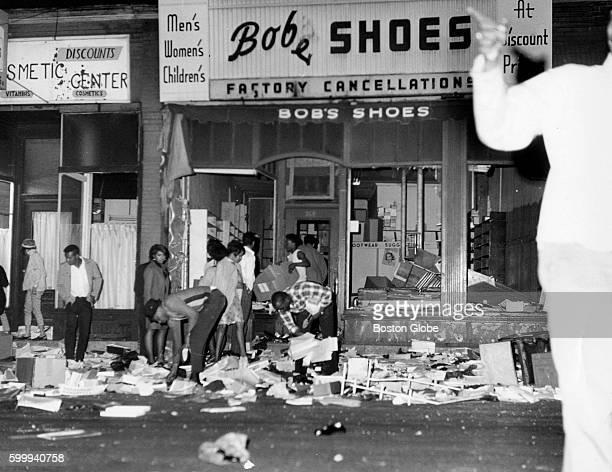 People loot a store on Blue Hill Avenue during riots in the Roxbury neighborhood of Boston on June 3 1967