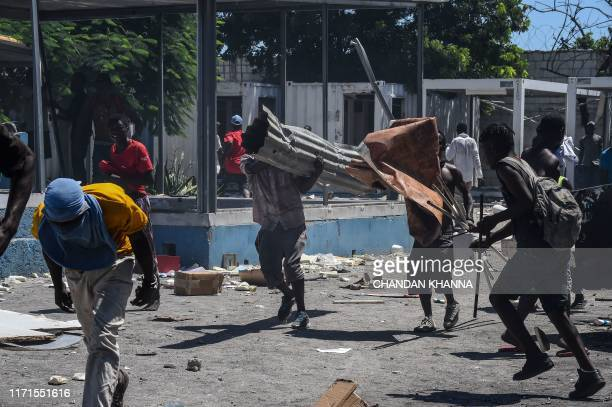 People loot inside a Police station in Cite Soleil during a protest in demand of the resignation of President Jovenel Moise in PortauPrince Haiti on...