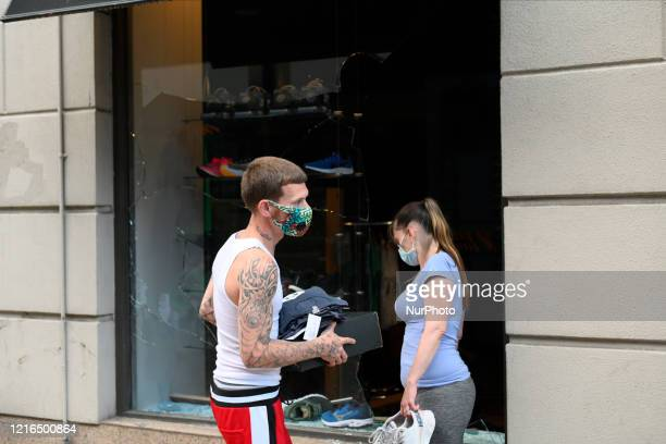 People loot sneakers from a store on Walnut Street in Philadelphia PA on May 30 2020 Protestors clash with police in cities around the nation when...