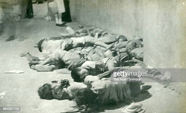People lost their homes by the atomic bomb sleep in the Hiroshima Station building on the first anniversary of the Hiroshima Atomic Bomb dropping on...