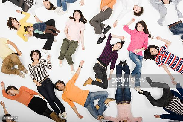 people lying down - lying on back stock pictures, royalty-free photos & images