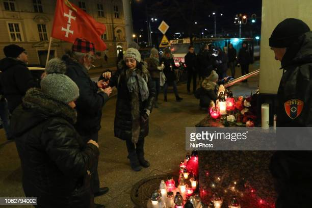 People lying flowers and lighting candles in front of Gdansk City Hall are seen in Gdansk, Poland on 14 January 2019 Citizens pay honour to the...